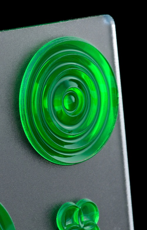 Picture of green fresnel lens array - 3D printed onto frosted surface finish