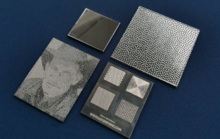 Picture of various Luximprint prints with reflective coatings applied