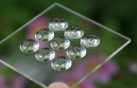Picture of 9 spherical lens domes in a garden photo set-up