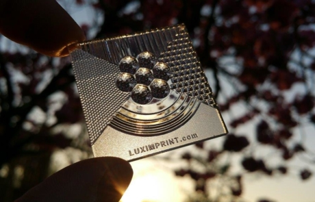 Picture of handheld Luximprint printed optics sample during sunset