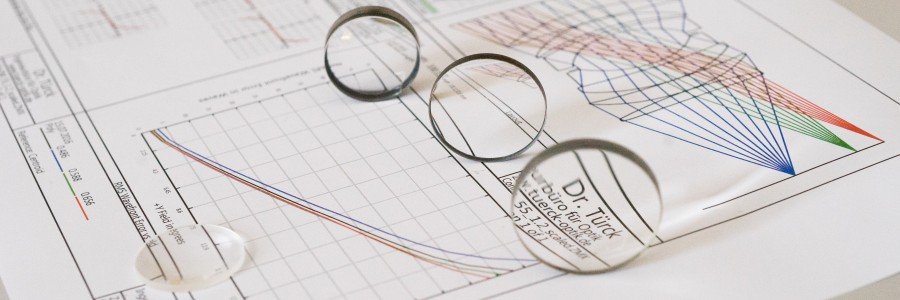 Image of Dr. Türck Engineering showing optics design sketches with overlay of lenses