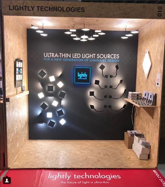 Image of Lightly Technologies booth with Luximprint Optographix on display