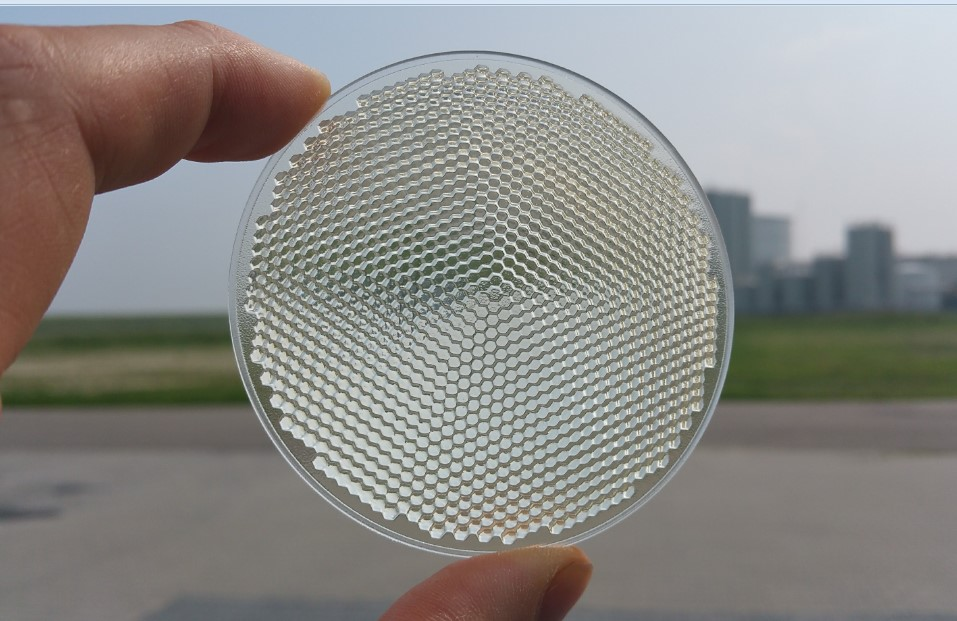 Image of printed faceted lens optic by Luximprint