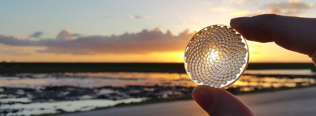 Image of handheld 3D printed fresnel sunflower lens