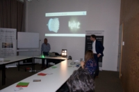 Image of Luximprint's Marco de Visser and Physionary Suresh Christopher addressing a group of Universiteit Gent students
