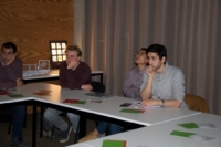 Picture of concentrated students listening to the printed optics story as told by Physionary and Luximprint