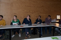 Image of European Master Students in Photonics concentrated listening to the 3D printed optics story
