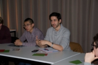 Image of student asking deepgoing questions on 3D printed optics during Ghent University Workshop session in the iGent Tower.