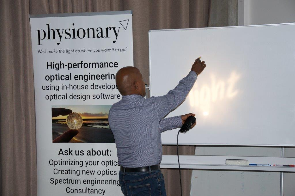 Photo of Suresh from Physionary explaining Faceted Lens Technology principles