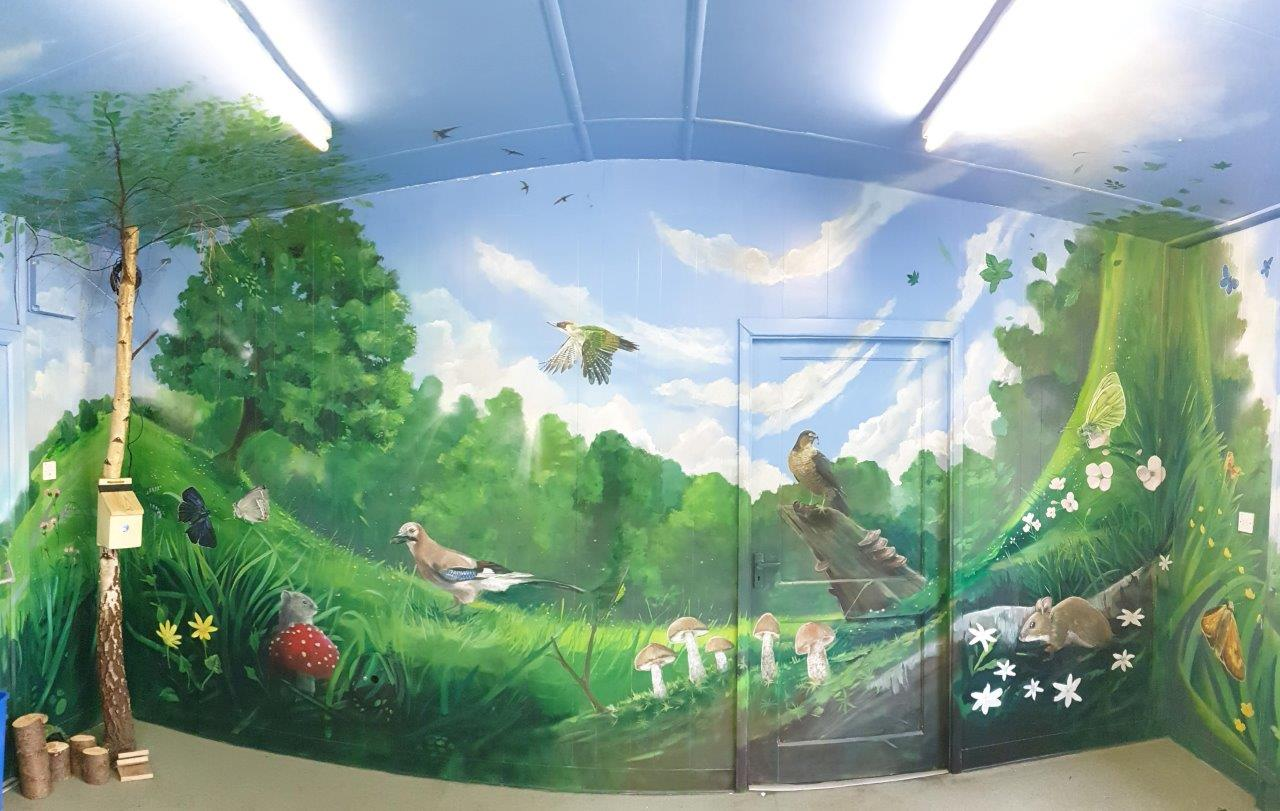 Image of Park Penallta washroom decorated with wall-painted minibeasts by Andy O'Rourke