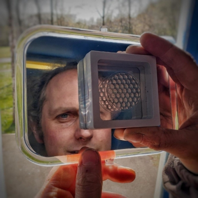Image of Mural Artist Andy O'Rourke holding a 3D printed lens array for his next project at Park Penallta