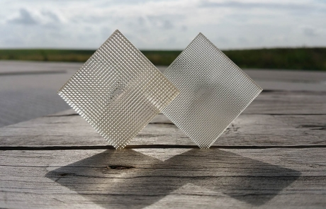Image by Luximprint showing a duo of 3D Printed Facet Lenses for Printed Optics Inspiration Gallery