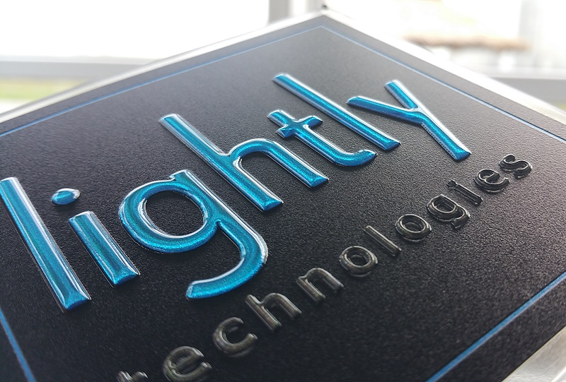 Image of Lightly Technologies logo with 3D printed logo typography