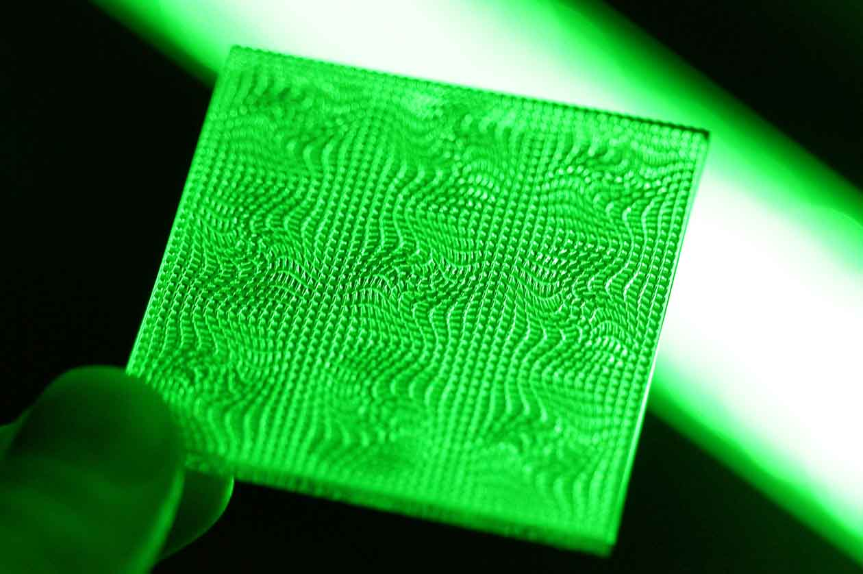 Image of handheld green-colored optical texture by Luximprint