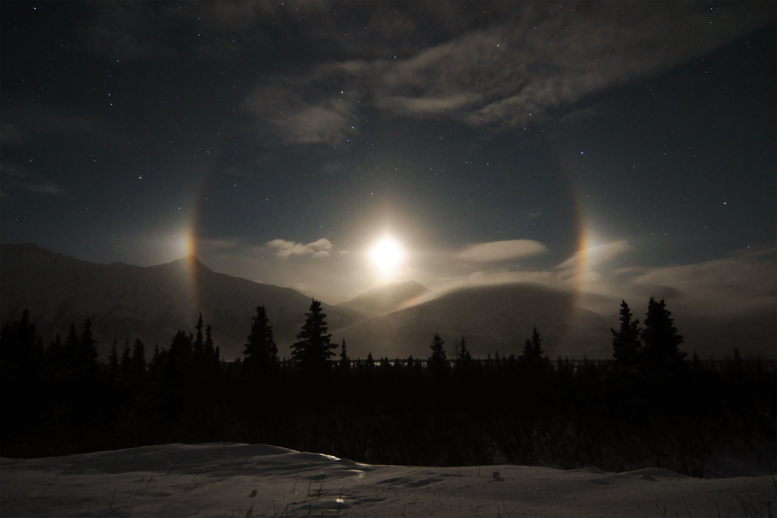 Image for mountains with sunset and eclipse as illustrative image for Luximprint Optics Design Hub